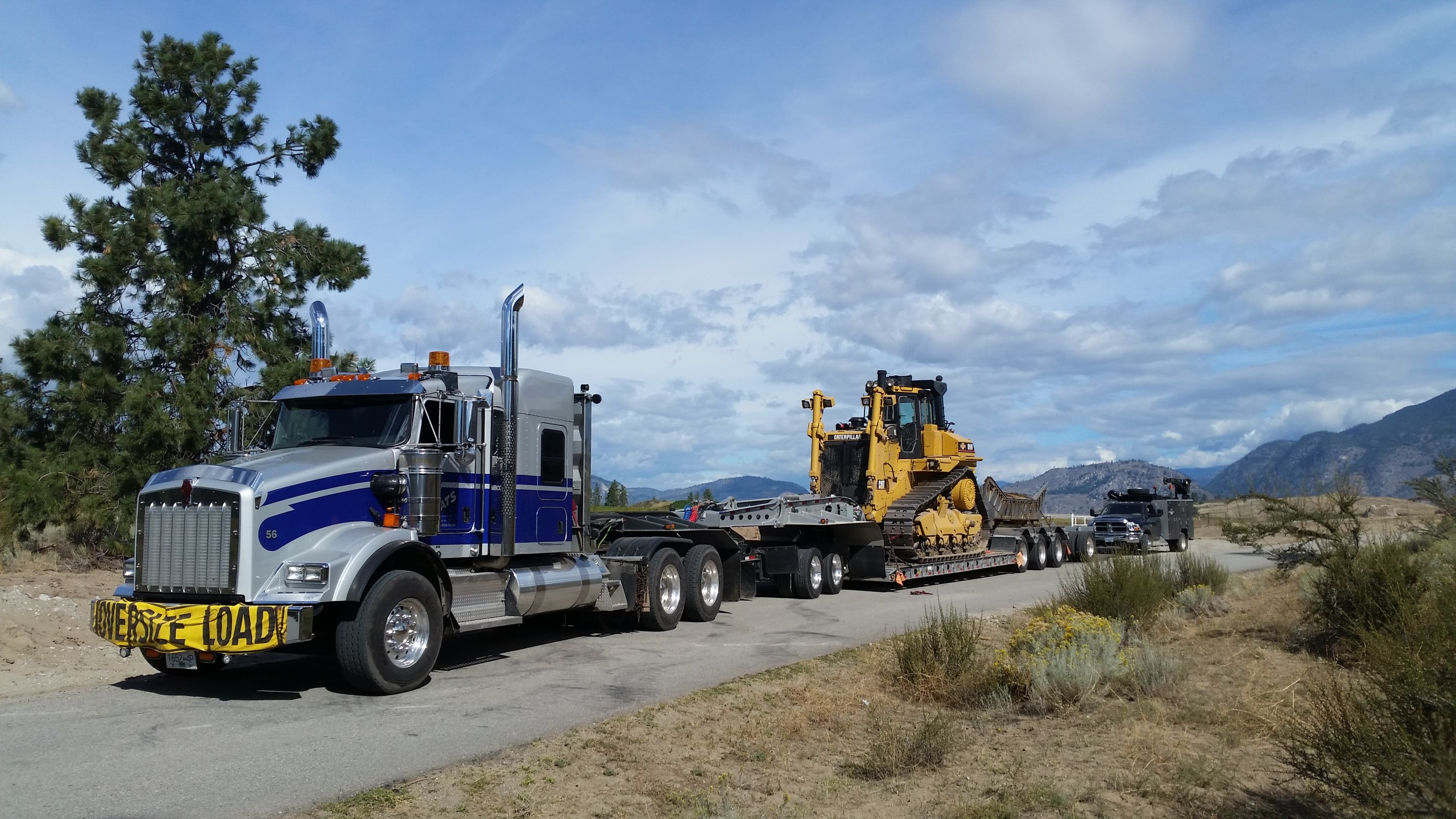 oversize load truck hauling tractor