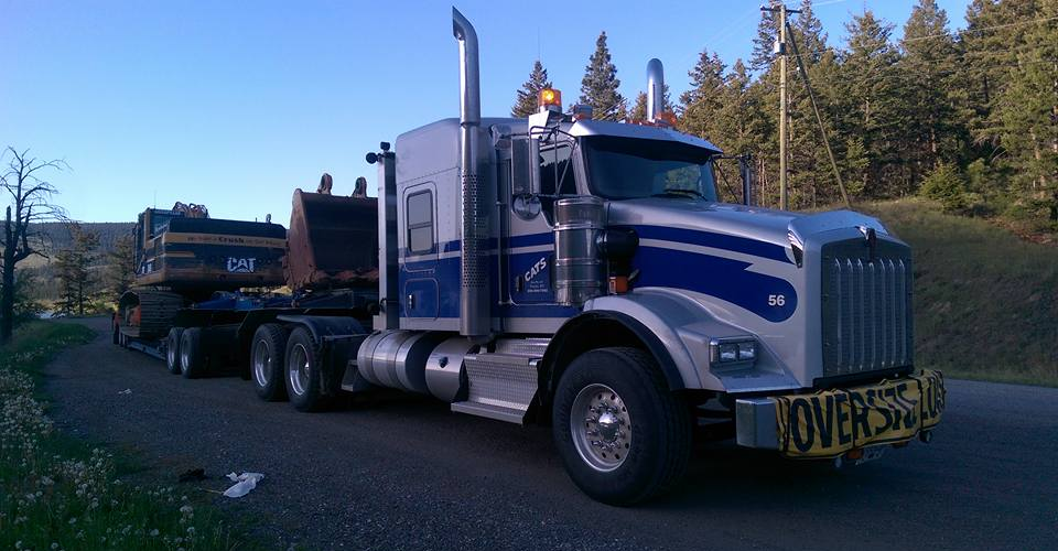 large silver and blue hauling truck